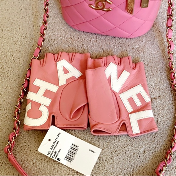 Pink leather Chanel logo fingerless gloves BNWT
